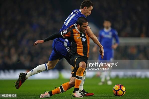 Chelsea's Serbian midfielder Nemanja Matic vies with Hull City's Brazilian midfielder Evandro during the English Premier League football match...