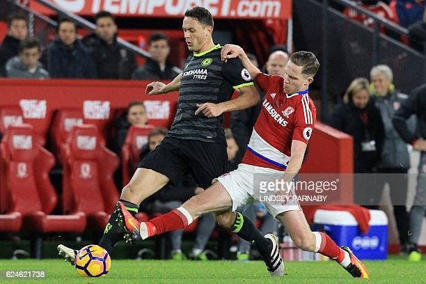 Chelsea's Serbian midfielder Nemanja Matic vies with Middlesbrough's English midfielder Adam Forshaw during the English Premier League football match...