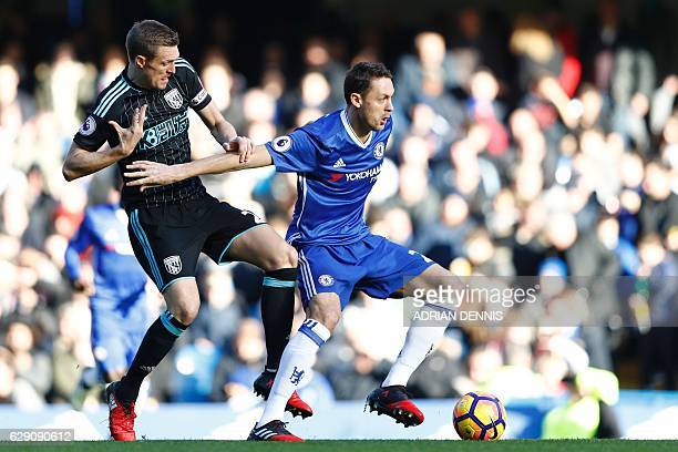 Chelsea's Serbian midfielder Nemanja Matic vies with West Bromwich Albion's Scottish midfielder Darren Fletcher during the English Premier League...