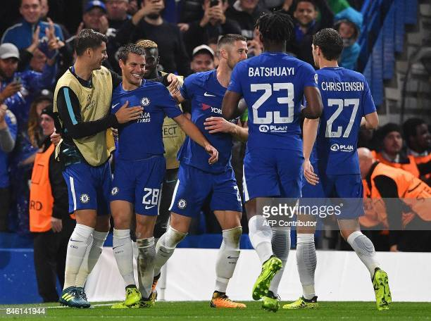 Chelsea's Spanish defender Cesar Azpilicueta celebrates scoring his team's third goal during the UEFA Champions League Group C football match between...