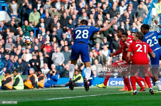 Chelsea's Spanish defender Cesar Azpilicueta heads the ball to scores his team's third goal during the English Premier League football match between...