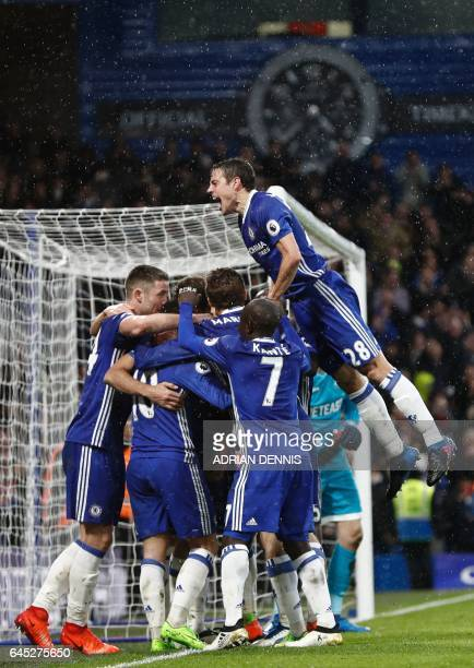 Chelsea's Spanish defender Cesar Azpilicueta jumps in to join the celebration after Chelsea's Brazilianborn Spanish striker Diego Costa scored their...
