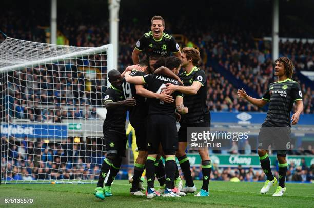 Chelsea's Spanish defender Cesar Azpilicueta jumps onto the celebration after Chelsea's Brazilian midfielder Willian scored their third goal during...