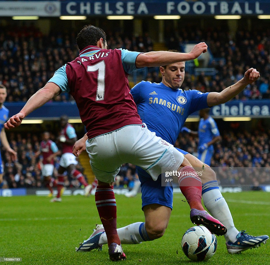 """Chelsea's Spanish defender Cesar Azpilicueta (R) vies for the ball with West Ham United's English midfielder Matt Jarvis (L) during the English Premier League football match between Chelsea and West Ham United at Stamford Bridge in London on March 17, 2013. USE. No use with unauthorized audio, video, data, fixture lists, club/league logos or """"live"""" services. Online in-match use limited to 45 images, no video emulation. No use in betting, games or single club/league/player publications."""