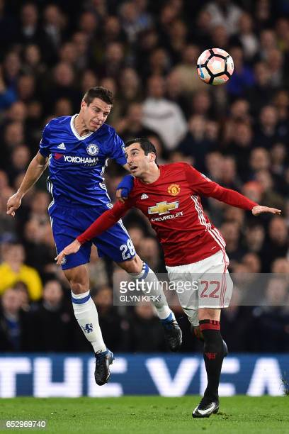 Chelsea's Spanish defender Cesar Azpilicueta vies with Manchester United's Armenian midfielder Henrikh Mkhitaryan during the English FA Cup quarter...