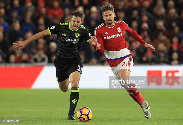 Chelsea's Spanish defender Cesar Azpilicueta vies with Middlesbrough's Uruguayan midfielder Gaston Ramirez during the English Premier League football...