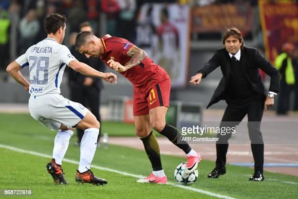 Chelsea's Spanish defender Cesar Azpilicueta vies with Roma's Croatian defender Aleksandar Kolarov as Chelsea's Italian head coach Antonio Conte...
