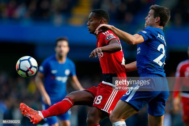 Chelsea's Spanish defender Cesar Azpilicueta vies with Watford's Peruvian midfielder Andre Carrillo during the English Premier League football match...
