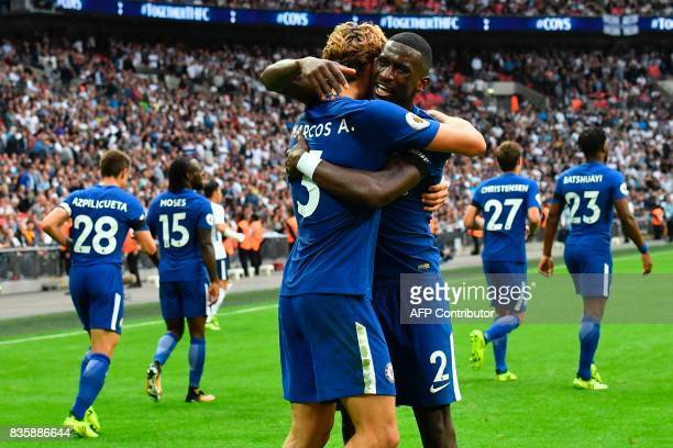 Chelsea's Spanish defender Marcos Alonso celebrates after he scored their second goal with Chelsea's German defender Antonio Rudiger during the...