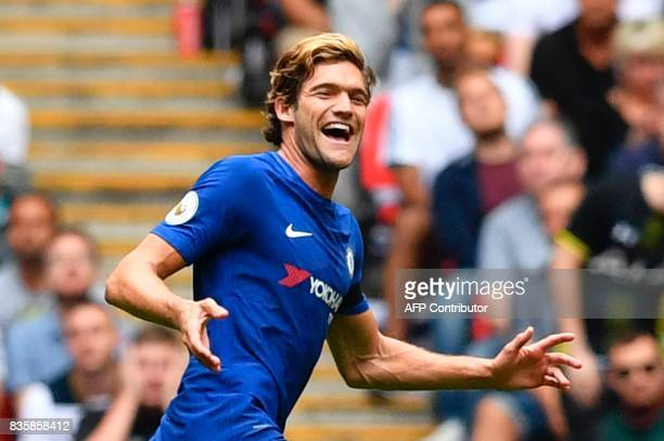 Chelsea's Spanish defender Marcos Alonso celebrates after scoring the opening goal during the English Premier League football match between Tottenham...