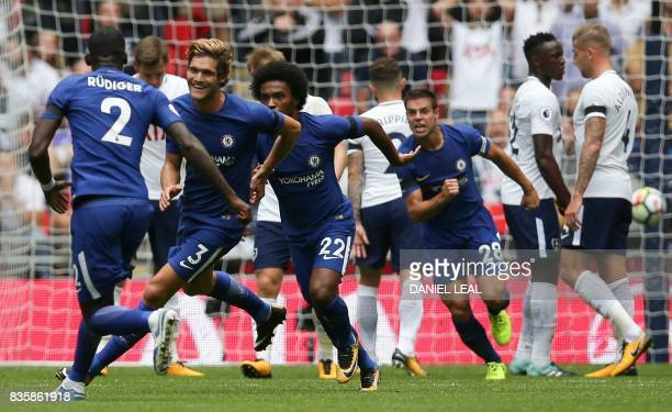 Chelsea's Spanish defender Marcos Alonso celebrates scoring the opening goal during the English Premier League football match between Tottenham...