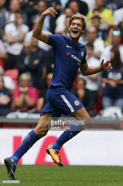 Chelsea's Spanish defender Marcos Alonso celebrates scoring the team's first goal during the English Premier League football match between Tottenham...