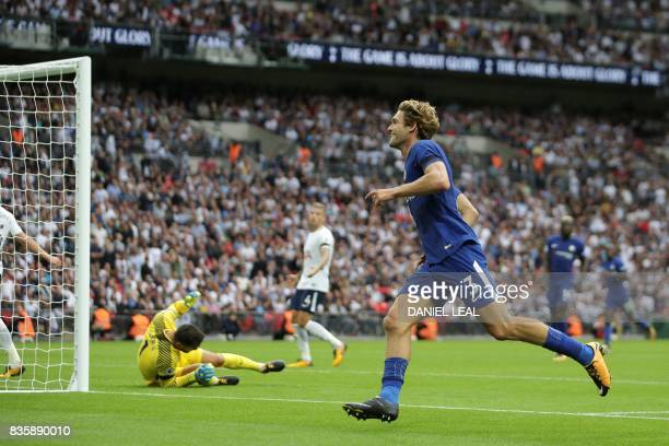 Chelsea's Spanish defender Marcos Alonso celebrates scoring their second goal during the English Premier League football match between Tottenham...