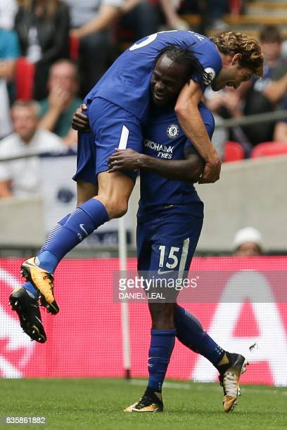 Chelsea's Spanish defender Marcos Alonso celebrates with Chelsea's Nigerian midfielder Victor Moses after scoring the opening goal during the English...
