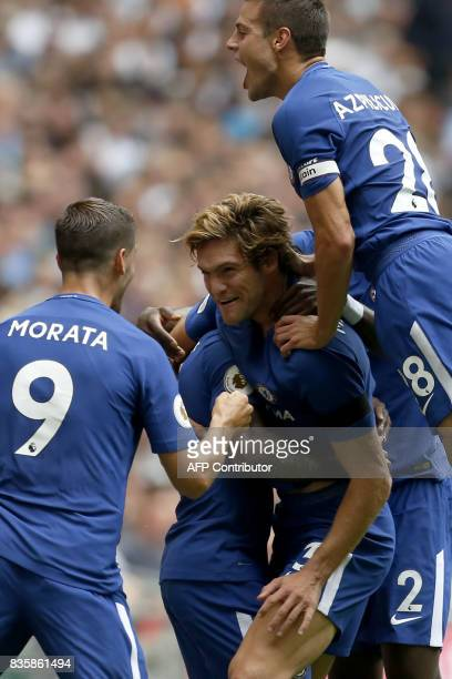 Chelsea's Spanish defender Marcos Alonso celebrates with teammates scoring the team's first goal from a free kick during the English Premier League...