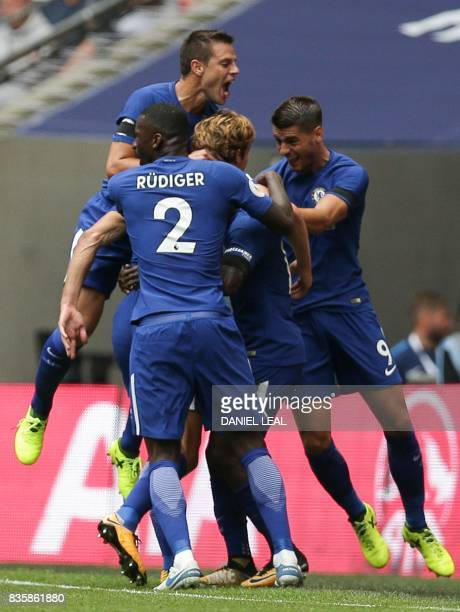 Chelsea's Spanish defender Marcos Alonso celebrates with teammates after scoring the opening goal during the English Premier League football match...