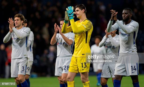 Chelsea's Spanish defender Marcos Alonso Chelsea's Spanish defender Cesar Azpilicueta Chelsea's Belgian goalkeeper Thibaut Courtois and Chelsea's...