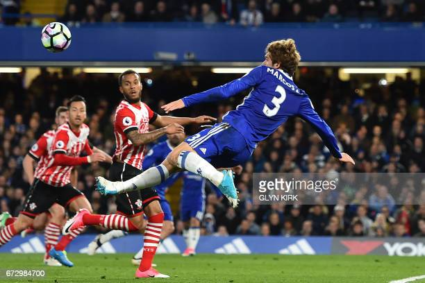Chelsea's Spanish defender Marcos Alonso fails to score with this acrobatic attempt during the English Premier League football match between Chelsea...