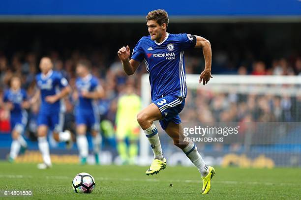 Chelsea's Spanish defender Marcos Alonso runs with the ball during the English Premier League football match between Chelsea and Leicester City at...