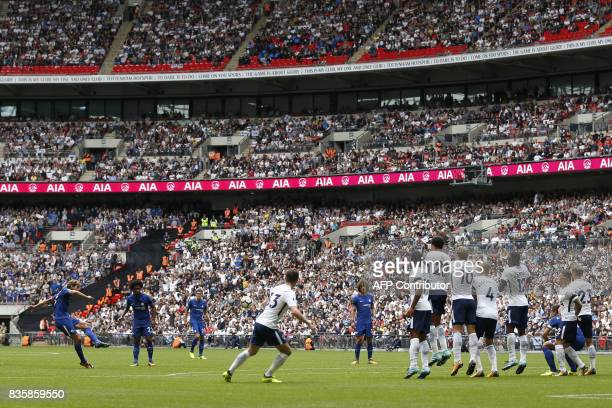 Chelsea's Spanish defender Marcos Alonso scores the team's first goal from a free kick during the English Premier League football match between...