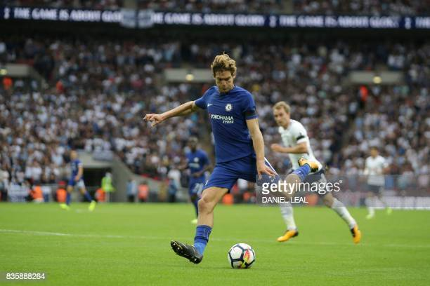 Chelsea's Spanish defender Marcos Alonso scores their second goal during the English Premier League football match between Tottenham Hotspur and...