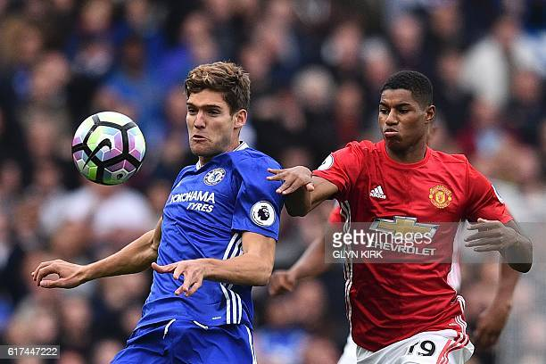 Chelsea's Spanish defender Marcos Alonso vies with Manchester United's English striker Marcus Rashford during the English Premier League football...