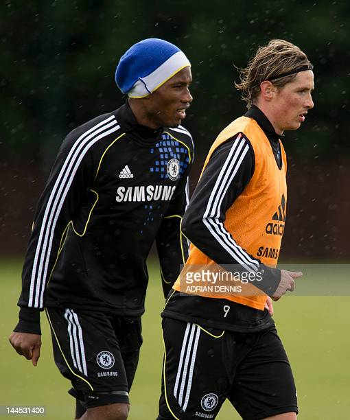 Chelsea's Spanish forward Fernando Torres and Ivorian forward Didier Drogba take part in a training session at the club's complex near Cobham on May...