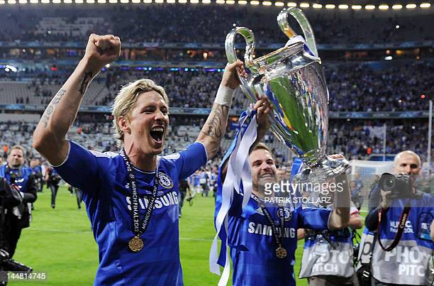 Chelsea's Spanish forward Fernando Torres and Spanish forward Juan Mata celebrate with their trophy after winning the UEFA Champions League final...