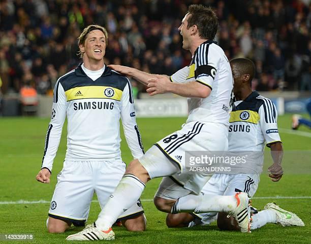 Chelsea's Spanish forward Fernando Torres celebrates with teammates midfielder Frank Lampard and Brazilian midfielder Ramires after scoring during...