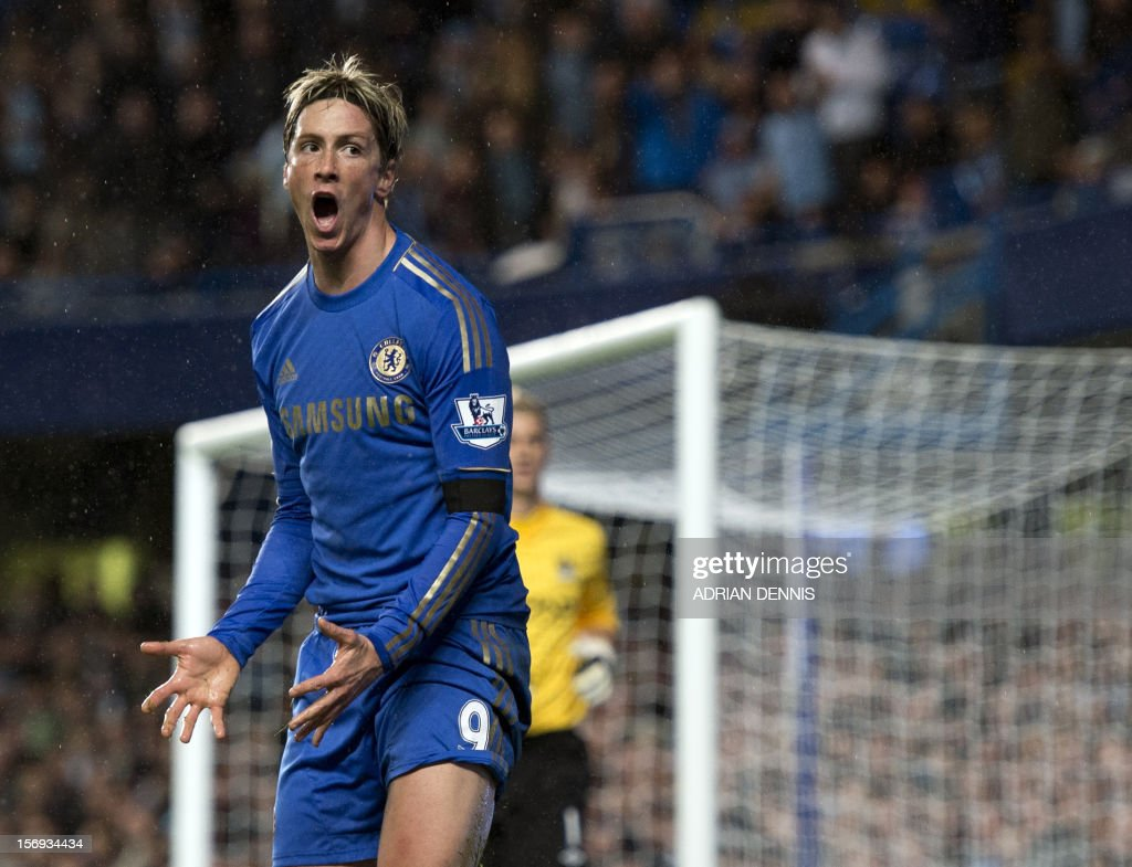 """Chelsea's Spanish forward Fernando Torres (L) reacts during the English Premier League football match between Chelsea and Manchester City at Stamford Bridge stadium in London on November 25, 2012. USE. No use with unauthorized audio, video, data, fixture lists, club/league logos or """"live"""" services. Online in-match use limited to 45 images, no video emulation. No use in betting, games or single club/league/player publications"""