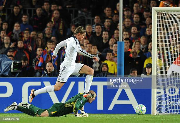 Chelsea's Spanish forward Fernando Torres scores past Barcelona's goalkeeper Victor Valdes during the UEFA Champions League second leg semifinal...