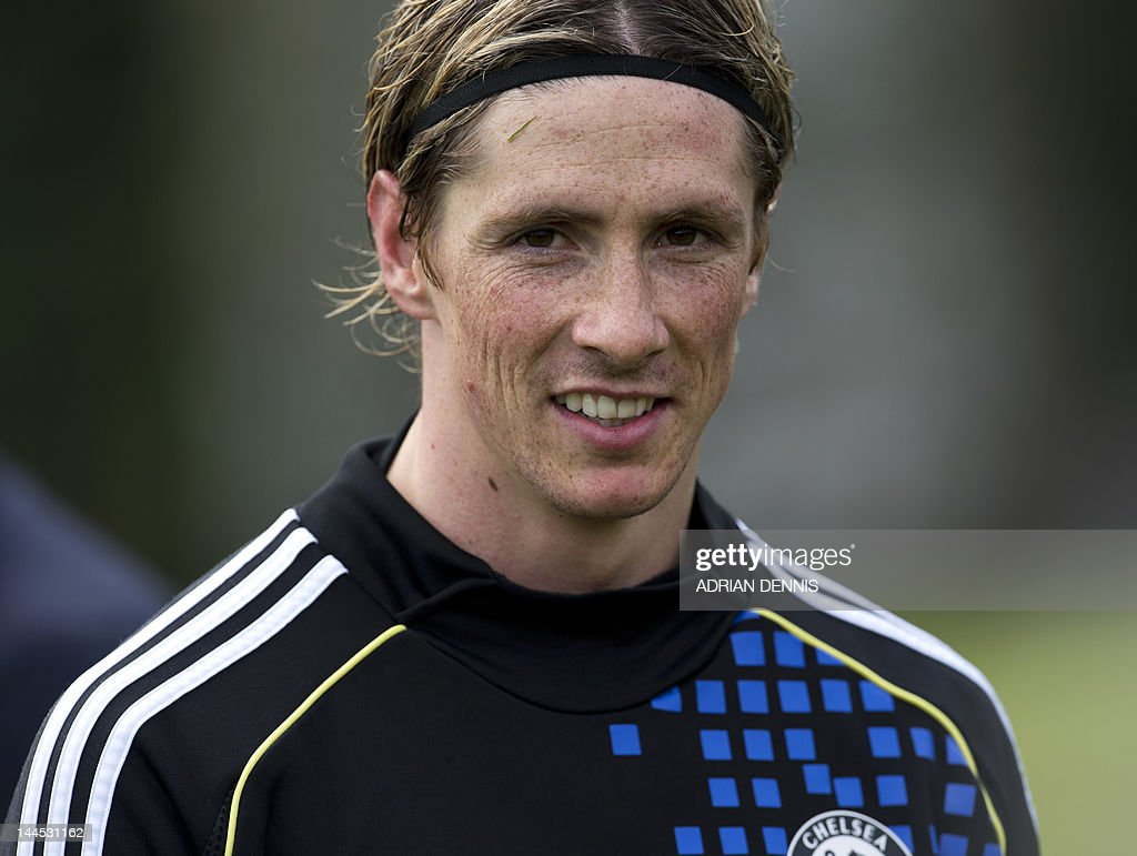 Chelsea's Spanish forward Fernando Torres walks off the pitch following a training session at the club's complex near Cobham on May 15 2012 Chelsea...
