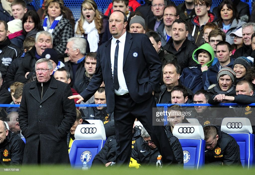 "Chelsea's Spanish interim manager Rafael Benitez (R) and Manchester United's Scottish manager Sir Alex Ferguson (L) during their English FA Cup quarter final replay football match against Manchester United at Stamford Bridge in London, England on April 1, 2013. Chelsea won 1-0. AFP PHOTO/GLYN KIRK RESTRICTED TO EDITORIAL USE. No use with unauthorized audio, video, data, fixture lists, club/league logos or ""live"" services. Online in-match use limited to 45 images, no video emulation. No use in betting, games or single club/league/player publications."