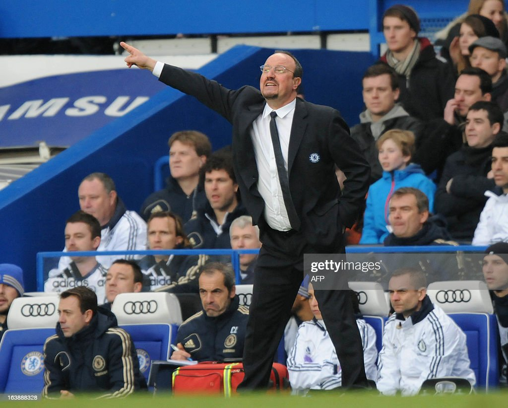 "Chelsea's Spanish interim manager Rafael Benitez reacts during the English Premier League football match between Chelsea and West Ham United at Stamford Bridge in London on March 17, 2013. USE. No use with unauthorized audio, video, data, fixture lists, club/league logos or ""live"" services. Online in-match use limited to 45 images, no video emulation. No use in betting, games or single club/league/player publications."