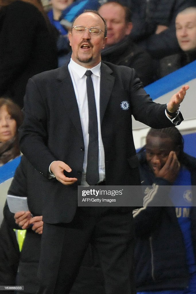 "Chelsea's Spanish interim manager Rafael Benitez reacts during the English Premier League football match between Chelsea and West Ham United at Stamford Bridge in London on March 17, 2013. AFP PHOTO / OLLY GREENWOOD USE. No use with unauthorized audio, video, data, fixture lists, club/league logos or ""live"" services. Online in-match use limited to 45 images, no video emulation. No use in betting, games or single club/league/player publications."