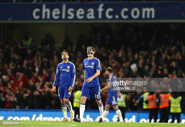 Chelsea's Spanish midfielder Cesc Fabregas and Chelsea's Serbian midfielder Nemanja Matic react after Bournemouth scored during the English Premier...
