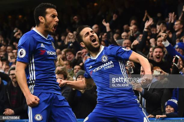 Chelsea's Spanish midfielder Cesc Fabregas and Chelsea's Spanish midfielder Pedro celebrate after Fabregas scored the opening goal during the English...