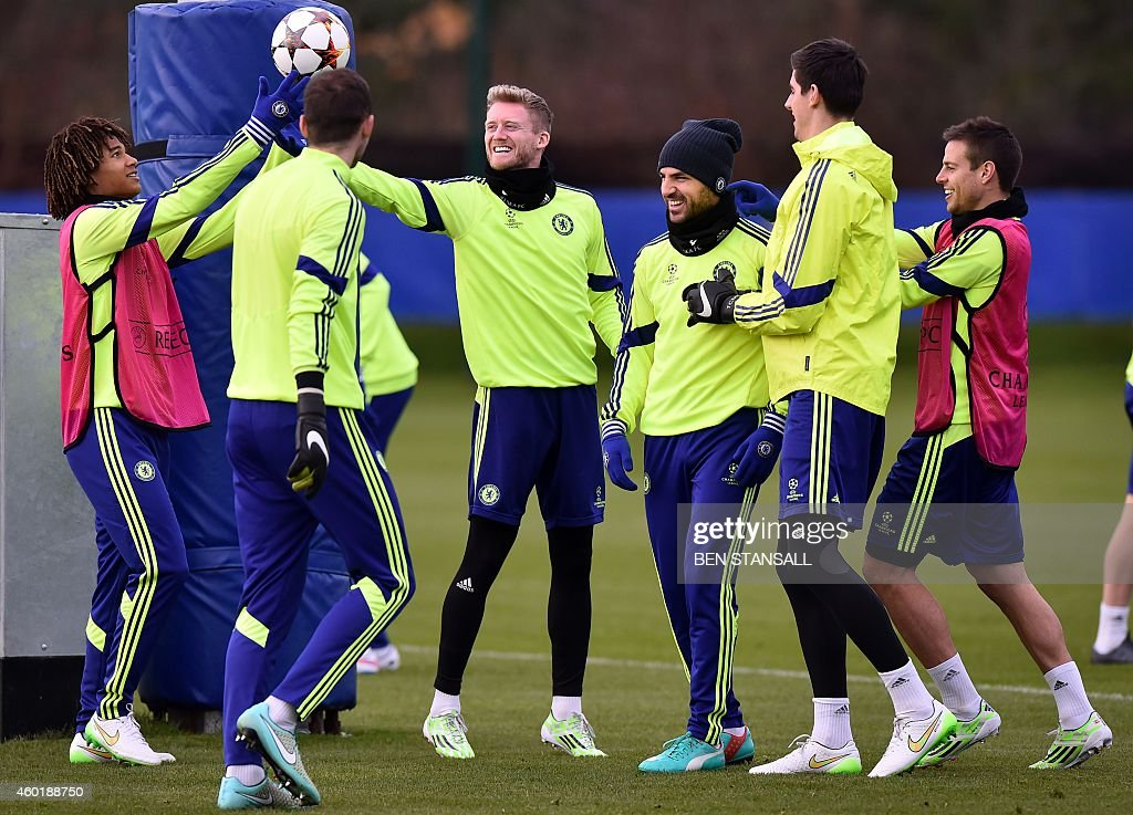 Chelsea's Spanish midfielder Cesc Fabregas and German striker Andre Schurrle attend a training session at the at Chelsea's training ground south of...