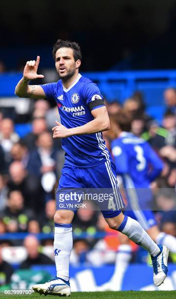Chelsea's Spanish midfielder Cesc Fabregas celebrates after scoring the opening goal of the English Premier League football match between Chelsea and...