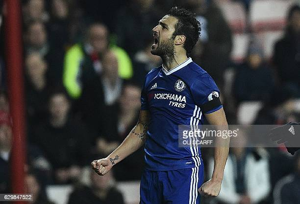 Chelsea's Spanish midfielder Cesc Fabregas celebrates scoring his team's first goal during the English Premier League football match between...