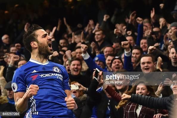 TOPSHOT Chelsea's Spanish midfielder Cesc Fabregas celebrates scoring the opening goal during the English Premier League football match between...