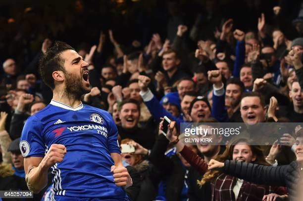 TOPSHOT Chelsea's Spanish midfielder Cesc Fabregas celebrates scoring the opening goal during the English Premier League football match between...