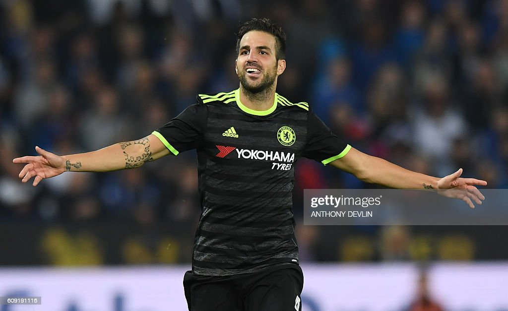 Chelsea's Spanish midfielder Cesc Fabregas celebrates scoring their fourth goal during extra-time in the English League Cup third round football match between Leicester City and Chelsea at King Power Stadium in Leicester, central England on September 20, 2016. / AFP / Anthony DEVLIN / RESTRICTED TO EDITORIAL USE. No use with unauthorized audio, video, data, fixture lists, club/league logos or 'live' services. Online in-match use limited to 75 images, no video emulation. No use in betting, games or single club/league/player publications. /