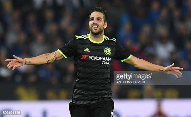 Chelsea's Spanish midfielder Cesc Fabregas celebrates scoring their fourth goal during extratime in the English League Cup third round football match...