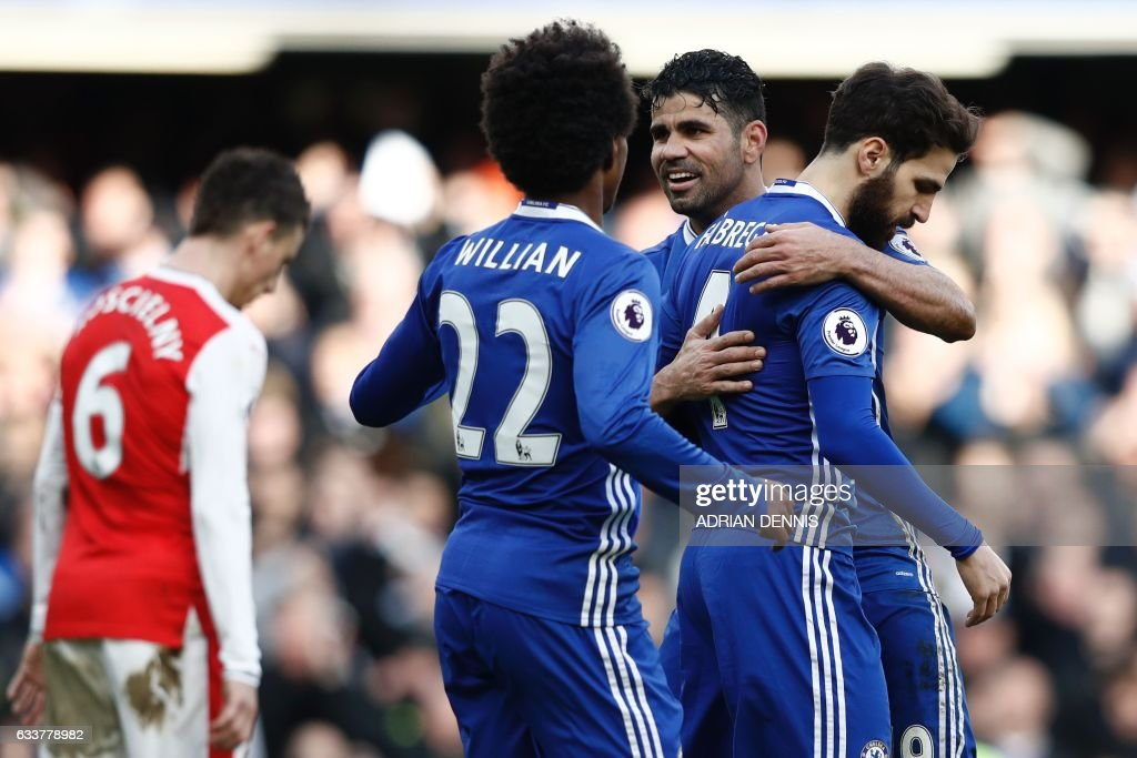 Chelsea's Spanish midfielder Cesc Fabregas (R) celebrates scoring their third goal with Chelsea's Brazilian-born Spanish striker Diego Costa (2R) during the English Premier League football match between Chelsea and Arsenal at Stamford Bridge in London on February 4, 2017. / AFP / Adrian DENNIS / RESTRICTED TO EDITORIAL USE. No use with unauthorized audio, video, data, fixture lists, club/league logos or 'live' services. Online in-match use limited to 75 images, no video emulation. No use in betting, games or single club/league/player publications. /
