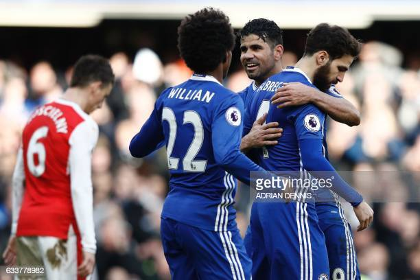 Chelsea's Spanish midfielder Cesc Fabregas celebrates scoring their third goal with Chelsea's Brazilianborn Spanish striker Diego Costa during the...