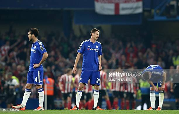 Chelsea's Spanish midfielder Cesc Fabregas Chelsea's Serbian midfielder Nemanja Matic and Chelsea's English defender Gary Cahill reacts after...