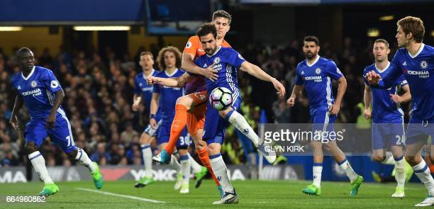 Chelsea's Spanish midfielder Cesc Fabregas clears the bal from Manchester City's English defender John Stones during the English Premier League...