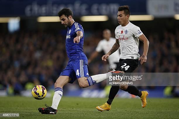 Chelsea's Spanish midfielder Cesc Fabregas plays the ball as Queens Park Rangers' Chilean striker Eduardo Vargas chases during the English Premier...