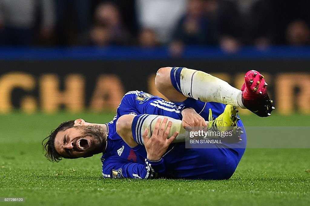 Chelsea's Spanish midfielder Cesc Fabregas reacts after being fouled by Tottenham Hotspur's Argentinian midfielder Erik Lamela during the English Premier League football match between Chelsea and Tottenham Hotspur at Stamford Bridge in London on May 2, 2016. / AFP / BEN STANSALL / RESTRICTED TO EDITORIAL USE. No use with unauthorized audio, video, data, fixture lists, club/league logos or 'live' services. Online in-match use limited to 75 images, no video emulation. No use in betting, games or single club/league/player publications. /